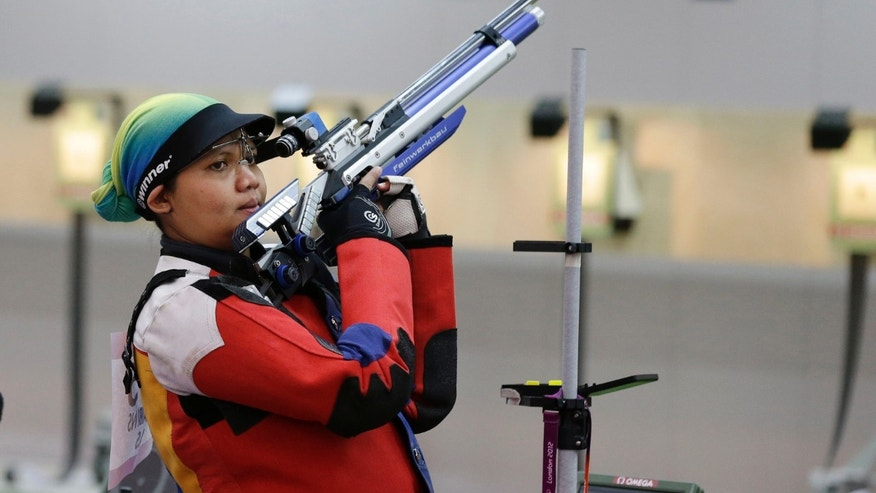 July 26, 2012: In this photo, Malaysian shooting athlete Nur Suryani Mohamed Taibi, who is eight months pregnant, shoots during a training session for the 10-meter air rifle event, at the Royal Artillery Barracks ahead of the the start of the 2012 Summer Olympics, in London.