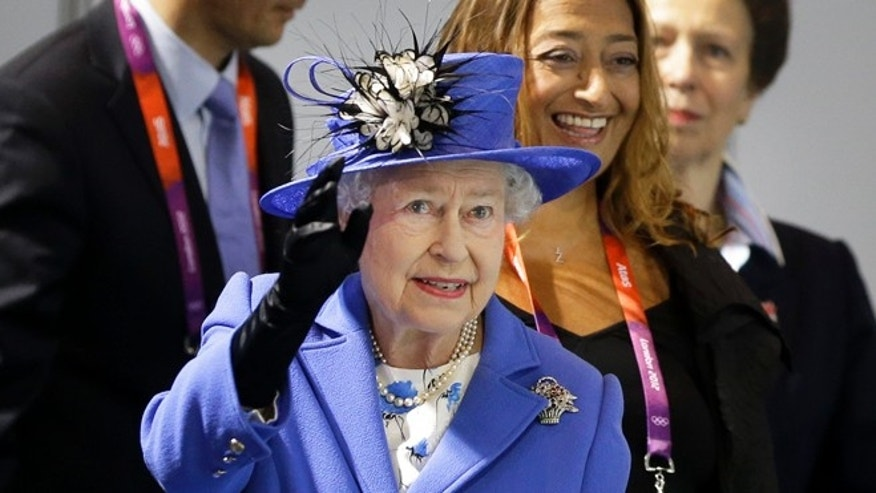 July 28, 2012: Britain's Queen Elizabeth II waves to spectators inside the Aquatics center during a visit to the Olympic Park at the 2012 Summer Olympics, in London.