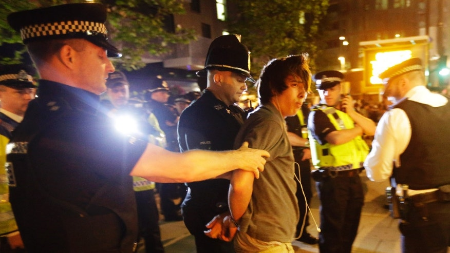 July 27, 2012: Officers arrests a cyclist after a Critical Mass bike protest outside the Olympic Park during the 2012 Summer Olympics Opening Ceremony in London.