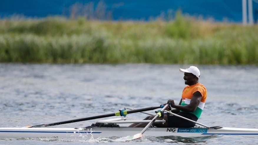 July 29, 2012: Niger's Hamadou Djibo Issaka strokes during a men's rowing single sculls repechage in Eton Dorney, near Windsor, England, at the 2012 Summer Olympics.