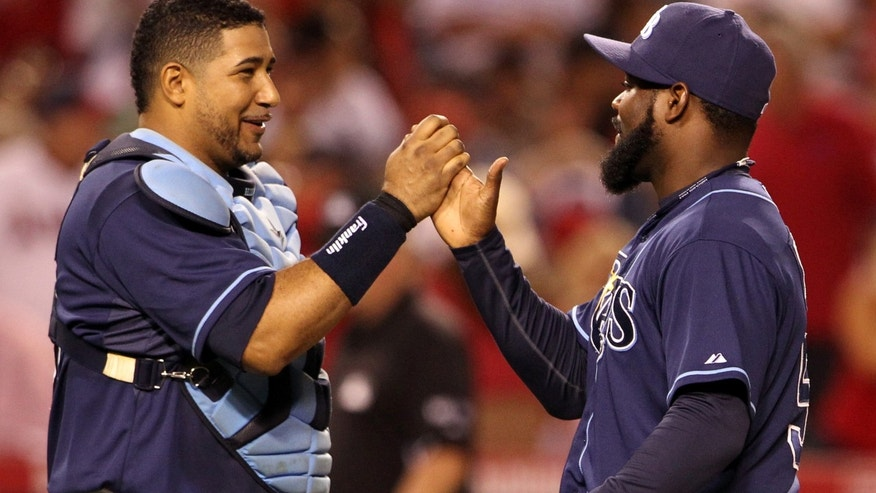 Tampa Bay Rays catcher Jose Molina, left, and reliever Fernando Rodney celebrate their 3-0 win over the Los Angeles Angels in a baseball game in Anaheim, Calif., Saturday, July 28, 2012. (AP Photo/Reed Saxon)
