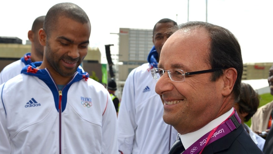 French President Francois Hollande, right, talks to French basketball player Tony Parker, at the Olympic Village during the 2012 Summer Olympics on Monday, July 30, 2012, in London. (AP Photo/Gabriel Bouys, Pool)