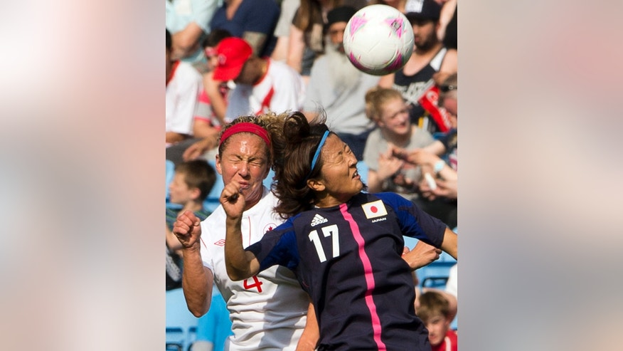 Canada's Carmelina Moscato, left, battles for a head ball with Japan's Yuki Ogimi during a group F women's soccer match at the London 2012 Summer Olympics, Wednesday, July 25, 2012, in Coventry, England. (AP Photo/The Canadian Press, Ryan Remiorz)