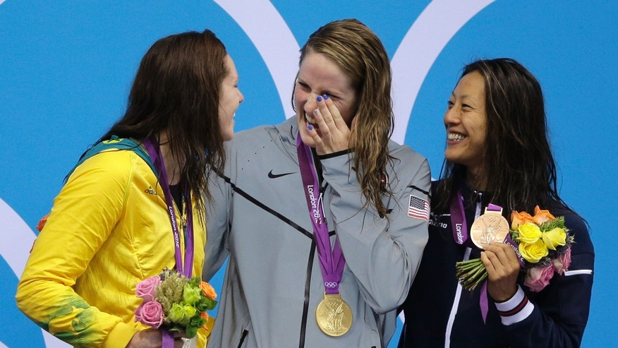 July 30, 2012: Australia's silver medalist Emily Seebhom, left, United States' gold medalist Missy Franklin, center, and Japan's bronze medalist Aya Terakawa, right, react after their wins in the women's 200-meter freestyle swimming semifinal at the Aquatics Centre in the Olympic Park during the 2012 Summer Olympics in London.