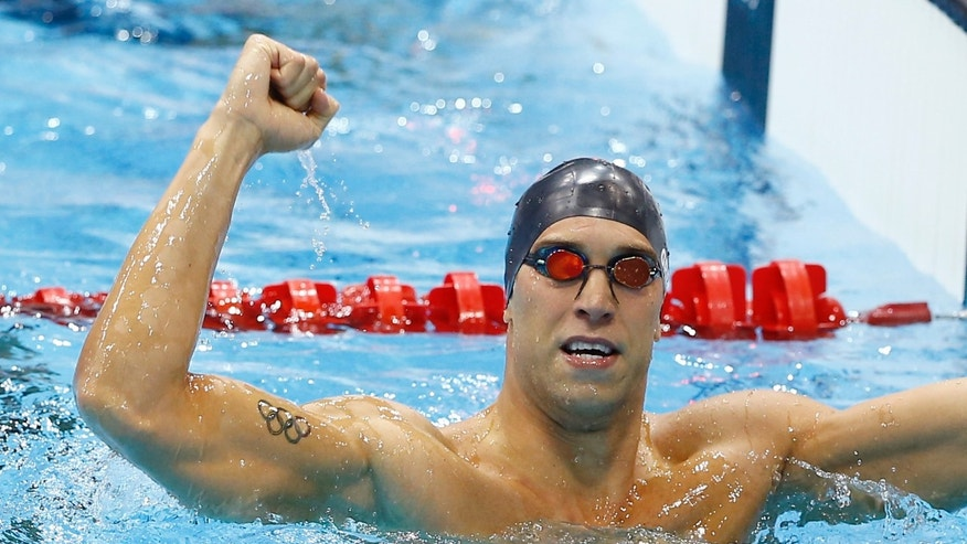 July 30, 2012: United States' Matthew Grevers celebrates his gold medal win in the men's 100-meter backstroke swimming final at the Aquatics Centre in the Olympic Park during the 2012 Summer Olympics in London.