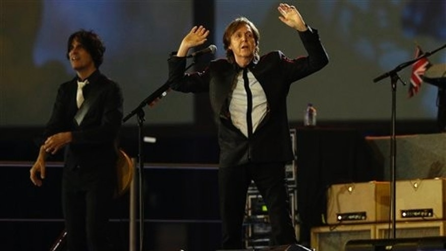 July 28, 2012: Sir Paul McCartney performs during the Opening Ceremony at the 2012 Summer Olympics in London.