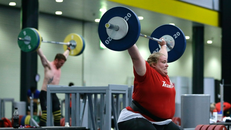 Weight-lifter Holley Mangold, of the United States, trains in preparation for the start of the 2012 Summer Olympics, Thursday, July 26, 2012, in London. (AP Photo/Hassan Ammar)