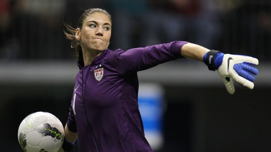 FILE - In this Friday, Jan. 27, 2012 file photo, United States goalkeeper Hope Solo (1) clears the ball from in front of her net during the second half against Costa Rica at the CONCACAF women's Olympic qualifying soccer game action at B.C. Place in Vancouver, Canada. Solo has lots to say heading into the Olympics. And she'll have even more to say once the games are done. The goalkeeper for the U.S. women's soccer team is releasing her memoir on Aug. 14 _ two days after the closing ceremony. (AP Photo/The Canadian Press, Jonathan Hayward, File)