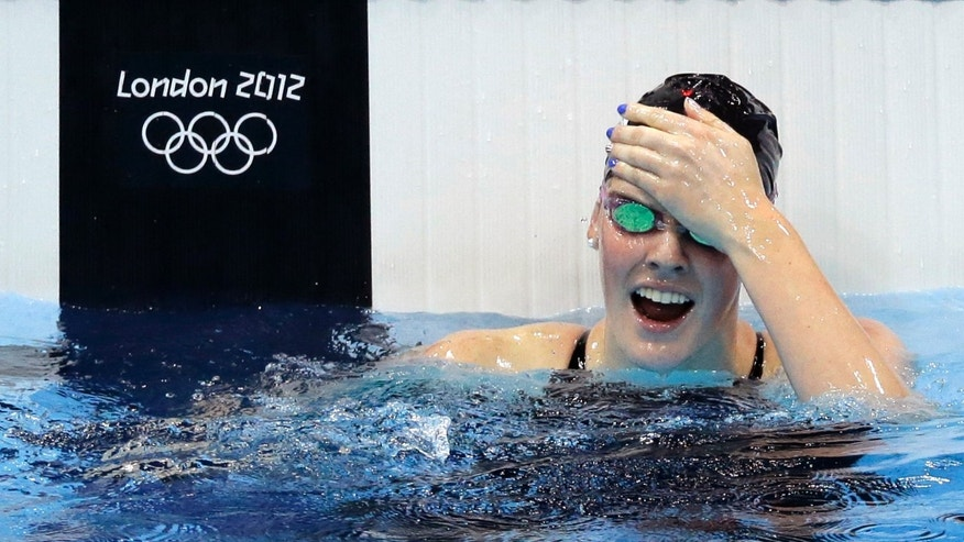 July 30, 2012: United States' Missy Franklin reacts to her gold medal win in the women's 100-meter backstroke swimming final at the Aquatics Centre in the Olympic Park during the 2012 Summer Olympics in London.