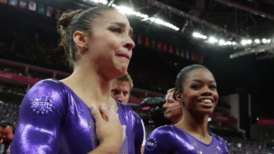 Ju;y 20, 2012: U.S. gymnast Alexandra Raisman, left, reacts after qualifying for the women's all-around final along with teammate Gabrielle Douglas during the Artistic Gymnastics women's qualification at the 2012 Summer Olympics.