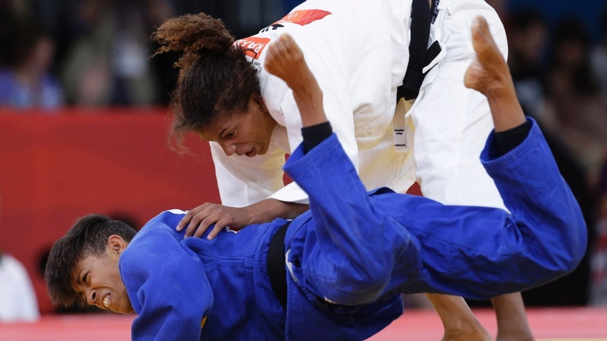 Miryam Roper of Germany competes with Rafaela Silva of Brazil, right, during the women's 57-kg judo competition at the 2012 Summer Olympics, Monday, July 30, 2012, in London. (AP Photo/Paul Sancya)