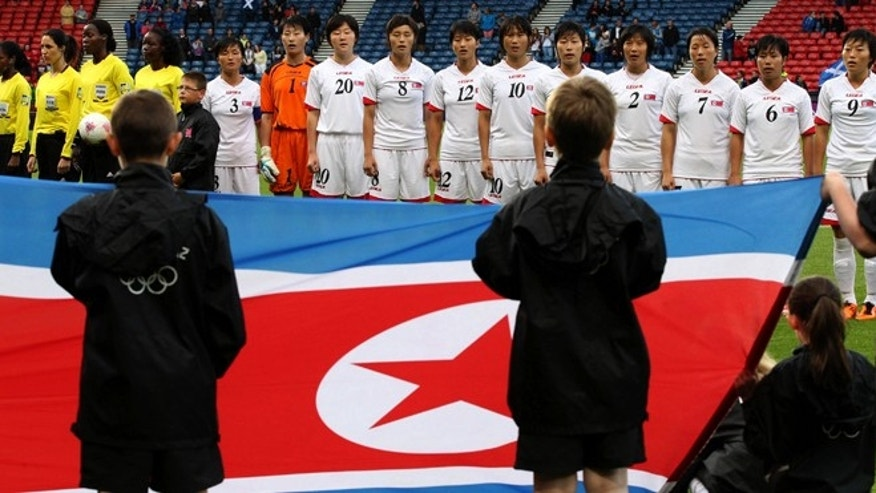 July 28, 2012: The North Korean women's soccer team line up before their group G match against France at the London 2012 Summer Olympics, at Hampden Park Stadium in Glasgow, Scotland.