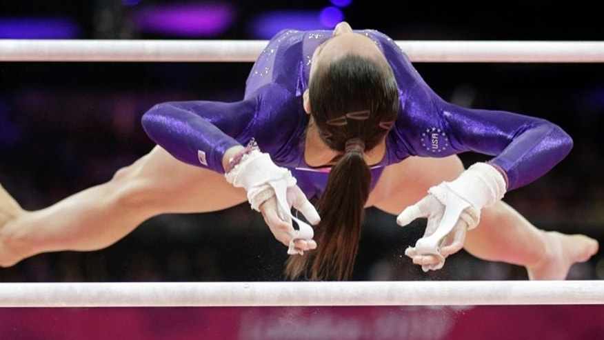 July 29, 2012: U.S. gymnast Jordyn Wieber performs on the uneven bars during the Artistic Gymnastics women's qualification at the 2012 Summer Olympics, in London.