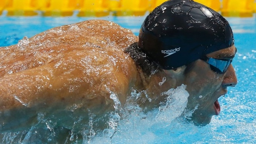 July 30, 2012: United States' Michael Phelps competes in the men's 200-meter butterfly swimming semifinal at the Aquatics Centre in the Olympic Park during the 2012 Summer Olympics in London.
