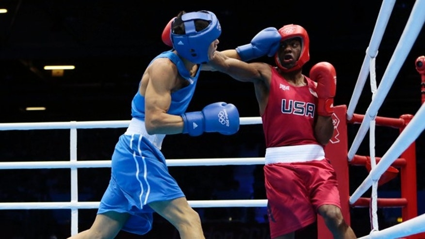 July 31, 2012: Jamel Herring, of the United States, right, fights Kazakhstan's Daniyar Yelessinov during their men's light welter 64-kg boxing match at the 2012 Summer Olympics, in London.