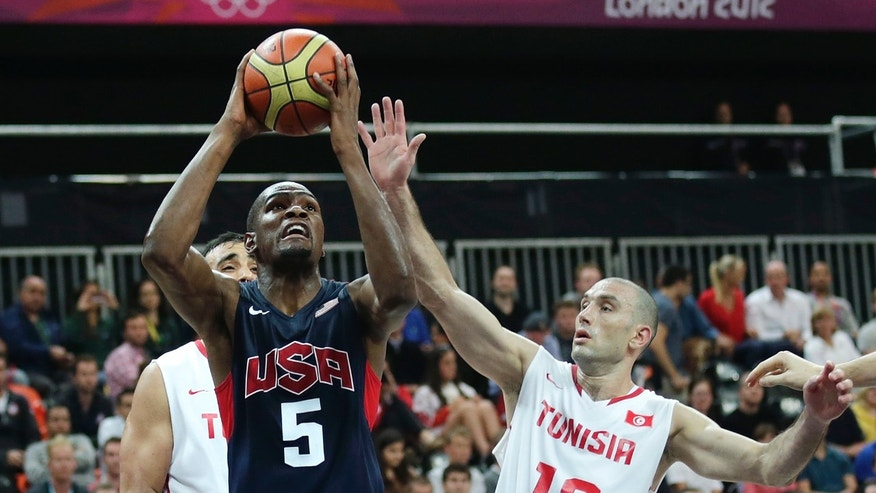 July 31, 2012: USA's Kevin Durant, left, drives to the basket against Tunisia's Amine Rzig during a men's basketball game at the 2012 Summer Olympics in London.