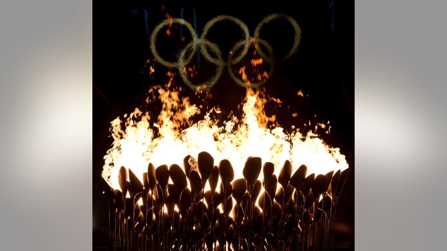 The Olympic cauldron burns following the opening ceremonies to the 2012 Summer Olympics in London on Saturday, July 28, 2012. (AP Photo/The Canadian Press, Sean Kilpatrick)