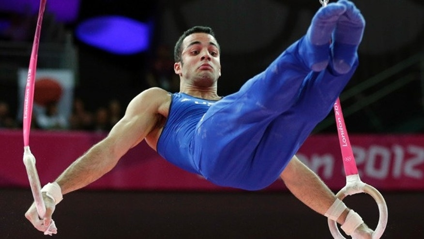 Aug. 1, 2012: U.S. gymnast Danell Leyva performs on the rings during the artistic gymnastics men's individual all-around competition at the 2012 Summer Olympics, in London.