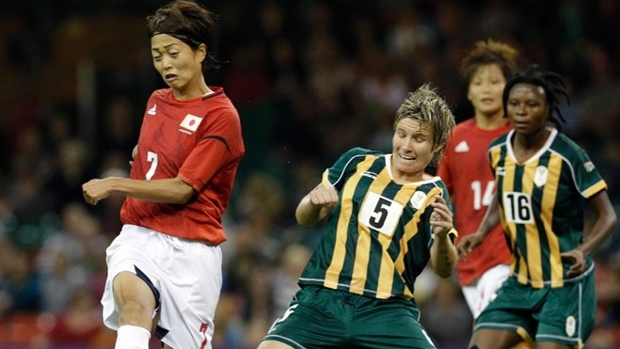 July 31, 2012: Japan's Kozue Ando, left, makes an attempt to score during the women's group F soccer match between Japan and South Africa, at the Millennium stadium in Cardiff, Wales, at the 2012 London Summer Olympics.