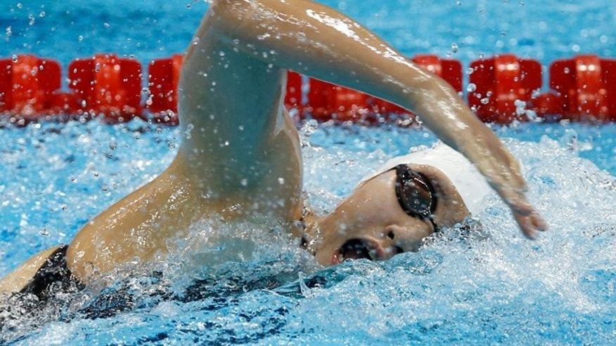 July 30, 2012: China's Ye Shiwen competes in a women's 200-meter individual medley swimming heat at the Aquatics Centre in the Olympic Park during the 2012 Summer Olympics in London.