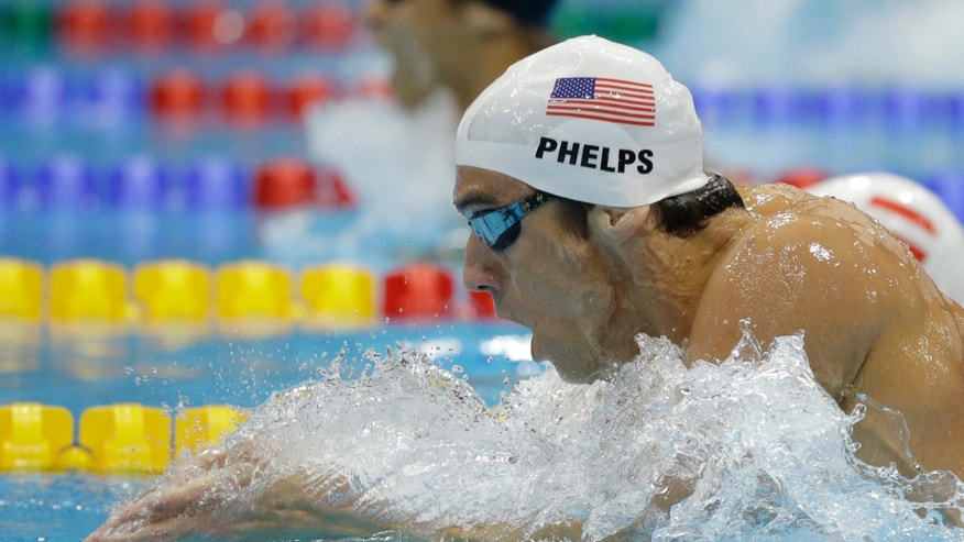 United States' Michael Phelps competes in a men's 200-meter individual medley at the Aquatics Centre in the Olympic Park during the 2012 Summer Olympics in London, Wednesday, Aug. 1, 2012. (AP Photo/Matt Slocum)