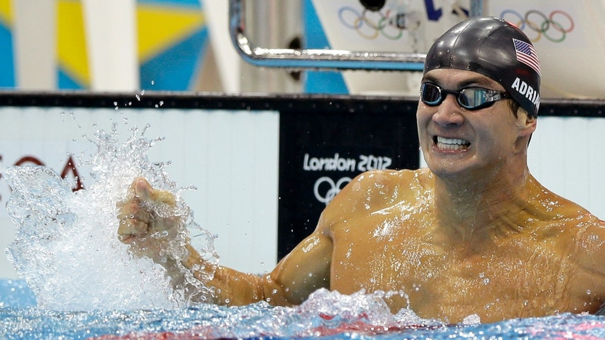 August 1: Nathan Adrian celebrates after winning the men's 100-meter freestyle swimming final at the Aquatics Centre in the Olympic Park during the 2012 Summer Olympics, in London. (AP)