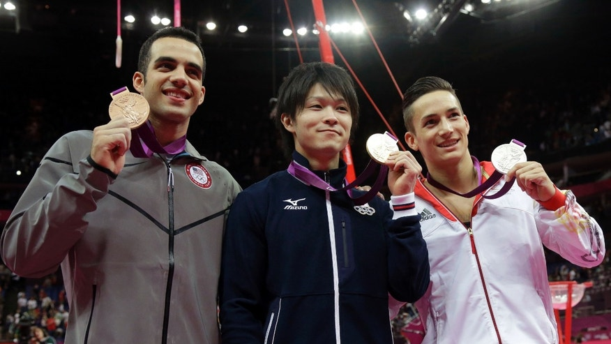 August 01, 2012: U.S. gymnast and bronze medallist Danell Leyva, left, Japanese gold medallist Kohei Uchimura, center, and German silver medallist Marcel Nyugen.