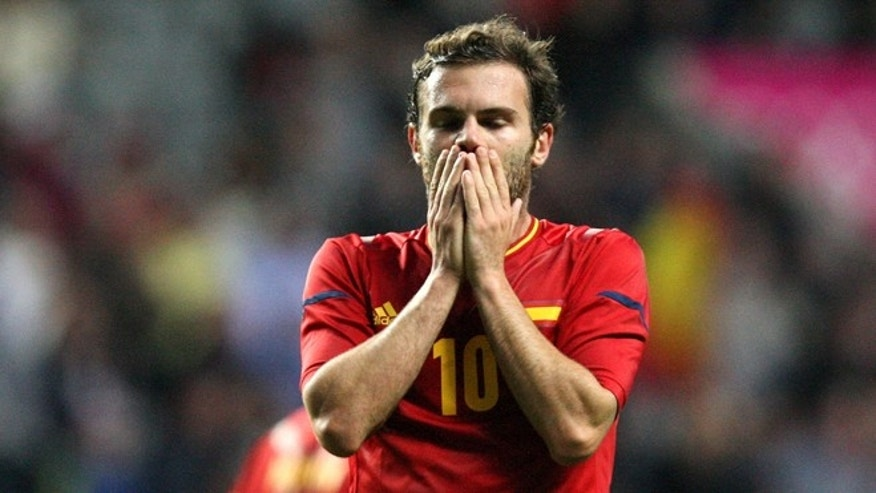 Spain's Juan Mata reacts after being defeated by Honduras at the end of the group D men's soccer match at St. James' Park, in Newcastle, England, during the London 2012 Summer Olympics, Sunday, July 29, 2012. (AP Photo/Scott Heppell)