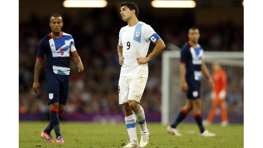 Luis Suarez of Uruguay looks dejected during the Men's Football first round Group A match between Great Britain and Uruguay on Day 5 of the London 2012 Olympic Games at Millennium Stadium on August 1, 2012 in Cardiff, Wales.