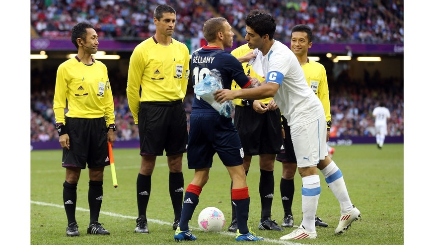 Craig Bellamy of Great Britain meets Luis Suarez of Uruguay at the start of the Men's Football first round Group A match between Great Britain and Uruguay on Day 5 of the London 2012 Olympic Games at Millennium Stadium on August 1, 2012 in Cardiff, Wales.