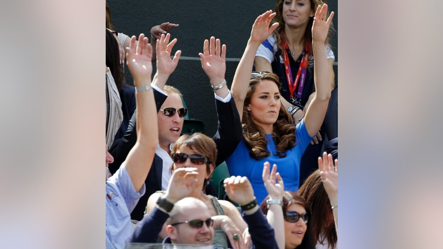 Prince William and Kate, Duchess of Cambridge, join the crowd in doing the wave at a match between Andy Murray of Great Britain and Nicolas Almagro of Spain at the All England Lawn Tennis Club at Wimbledon, in London, at the 2012 Summer Olympics, Thursday, Aug. 2, 2012. (AP Photo/Mark Humphrey)