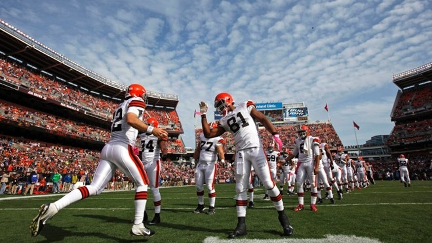 Oct. 23, 2011: In this file photo, Cleveland Browns' quarterback Colt McCoy (12) is greeted by his team during player introductions before taking on the Seattle Seahawks in an NFL football game in Cleveland.