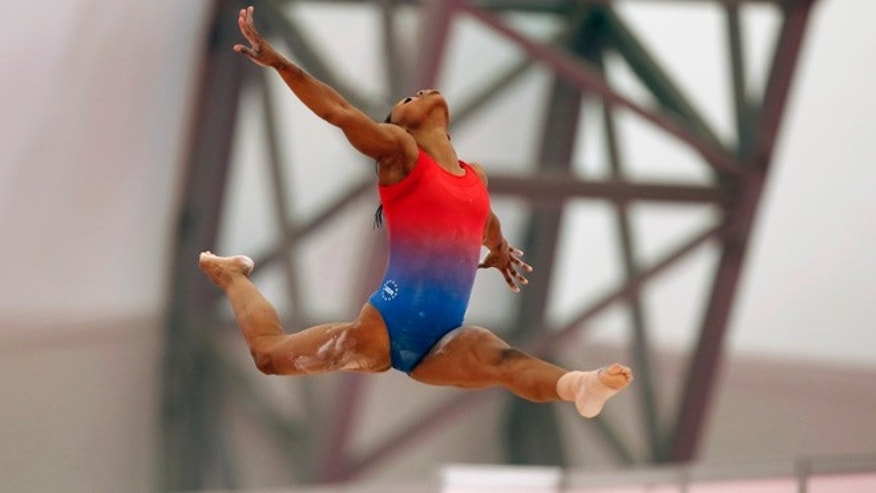 July 24, 2012: U.S. gymnast Gabby Douglas performs on the beam as she trains in a practice arena ahead of the 2012 Summer Olympics, in London.