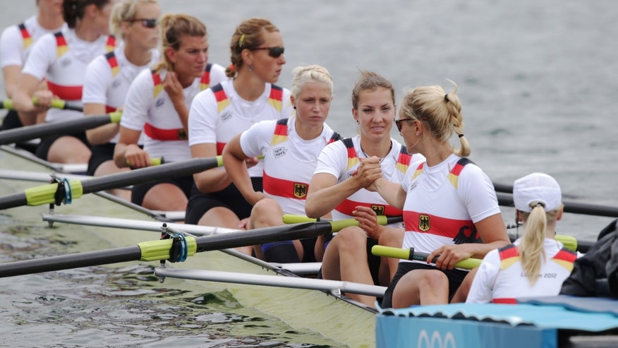 Germany's, from right, Laura Schwensen, Costanze Siering, Kathrin Marchand, Nadja Drygalla, Ulrike Sennewald, Katrin Thiem, Daniela Schultze, Julia Lepke, and Ronja Schett prior to the start of women's rowing eight repechage in Eton Dorney, near Windsor, England, at the 2012 Summer Olympics, Tuesday, July 31, 2012. They finished last and failed to qualify to the final. (AP Photo/Armando Franca)