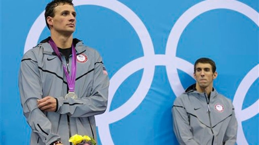 Aug. 2, 2012: Michael Phelps, right, and Ryan Lochte pose with their medals for the men's 200-meter individual medley swimming final at the Aquatics Center in the Olympic Park during the 2012 Summer Olympics in London on Thursday. Phelps won gold, Lochte silver.