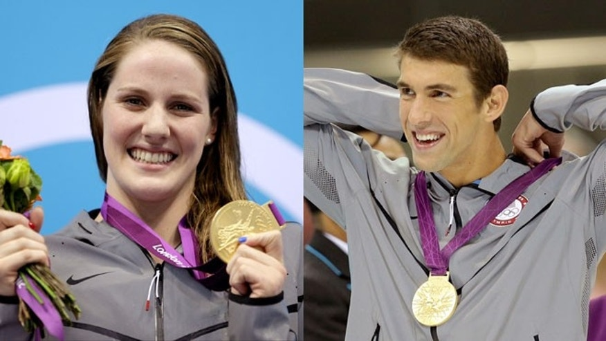 August 3: Team USA's Missy Franklin and Michael Phelps accept their gold medals for the women's 200m backstroke and men's 100m butterfly, respectively.