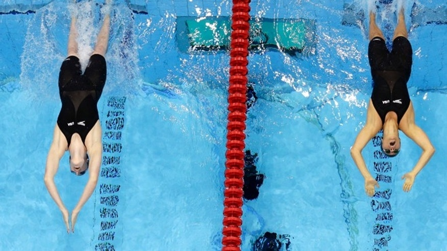 Aug. 3, 2012: United States' Missy Franklin, left, and teammate Elizabeth Beisel start in the women's 200-meter backstroke final at the Aquatics Centre in the Olympic Park during the 2012 Summer Olympics in London.