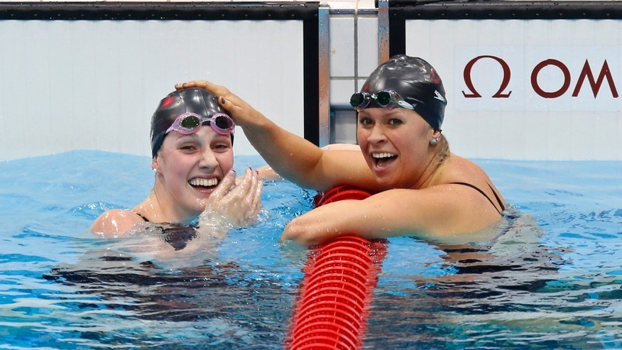 August 3: Missy Franklin, left, and compatriot Elizabeth Beisel celebrate after their first and third place finishes in the women's 200m backstroke final at the Aquatics Centre in the Olympic Park.