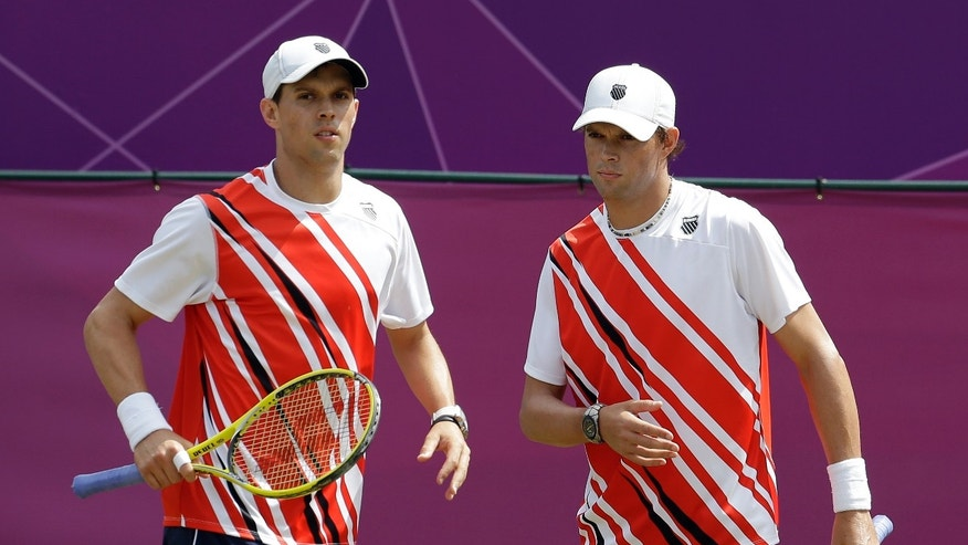 Aug. 3, 2012: Brothers and doubles partners Mike, left, and Bob Bryan play against Richard Gasquet and Julien Benneteau of France at the All England Lawn Tennis Club at Wimbledon, in London, at the 2012 Summer Olympics.