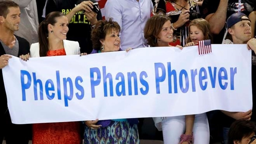 Aug. 4, 2012: U.S swimmer Michael Phelps' family hold a banner up as he swims in the 4 x 100-meter medley relay final at the Aquatics Centre in the Olympic Park during the 2012 Summer Olympics in London.