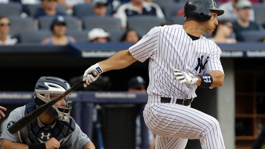 New York Yankees' Raul Ibanez swings on a two-run single in the sixth inning of their baseball game against the Seattle Mariners at Yankee Stadium in New York, Sunday, Aug. 5, 2012. (AP Photo/Kathy Willens)
