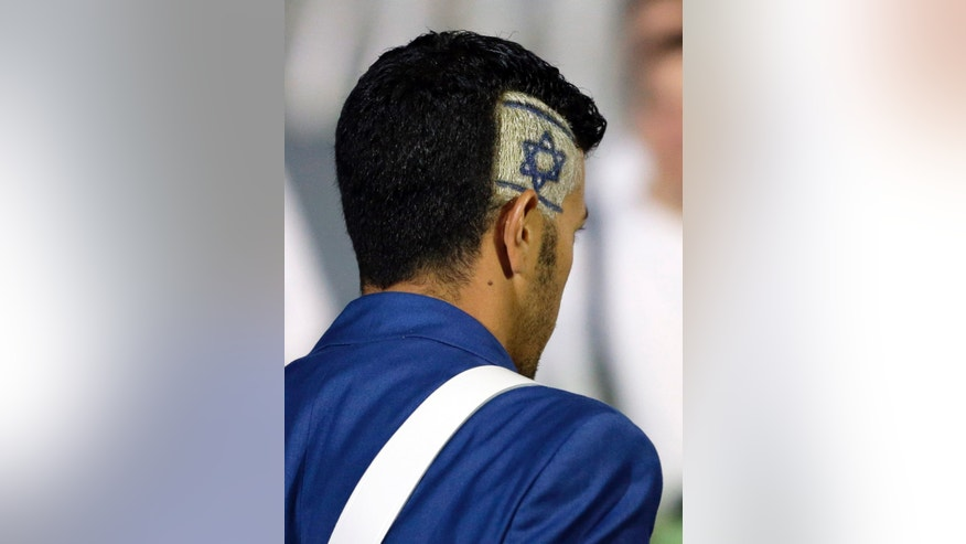 An Israeli athlete has his country's flag as a part of his a hairstyle during the Opening Ceremony at the 2012 Summer Olympics, Friday, July 27, 2012, in London. (AP Photo/Matt Slocum)