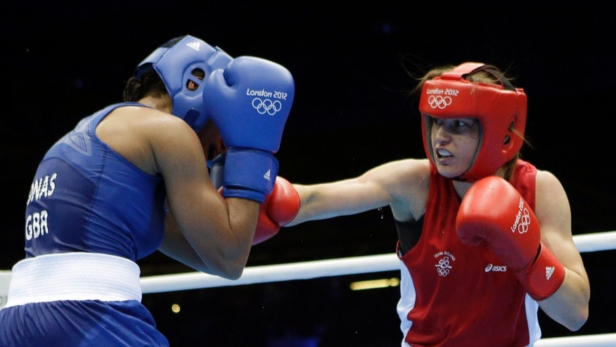 Ireland's Katie Taylor, right, fights Britain's Natasha Jonas in a women's lightweight 60-kg quarterfinal boxing match at the 2012 Summer Olympics, Monday, Aug. 6, 2012, in London. (AP Photo/Patrick Semansky)
