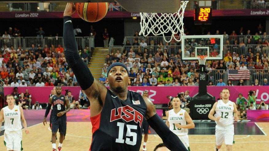 Aug. 04, 2012: Carmelo Anthony (L) of the United States goes to the basket against  Linas Kleiza of Lithuania  during the Men's Basketball Preliminary Round match between Lithuania and the United States on Day 8 of the London 2012 Olympic Games at Basketball Arena in London, England.
