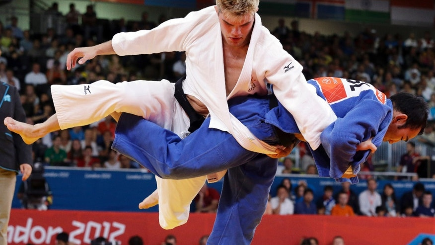 July 30, 2012: Nicholas Delpopolo of the United States, left, and  Nyam Ochir  Sainjargal of Mongolia compete during the men's 73-kg judo competition at the 2012 Summer Olympics in London.