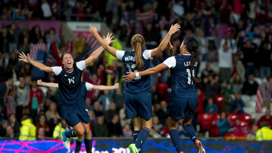 Aug. 6, 2012: United States' Alex Morgan, center, celebrates with teammates including Abby Wambach, left, and Sydney Leroux after the winning goal was scored past Canada's goalkeeper Erin Mcleod during their semifinal women's soccer match at the 2012 London Summer Olympics, Monday, at Old Trafford Stadium in Manchester, England.
