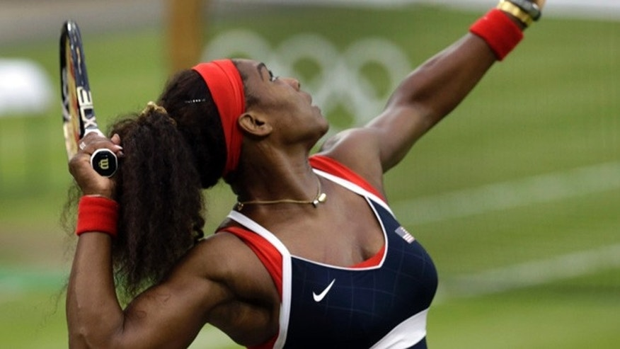 Aug. 1, 2012: Serena Williams of the United States serves to Vera Zvonareva of Russia at the All England Lawn Tennis Club in Wimbledon, London at the 2012 Summer Olympics.