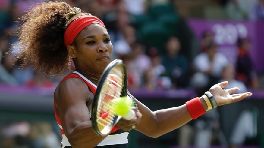 Aug. 4, 2012: United States' Serena Williams returns a shot to Maria Sharapova of Russia in the women's singles gold medal match at the All England Lawn Tennis Club at Wimbledon, in London, at the 2012 Summer Olympic.