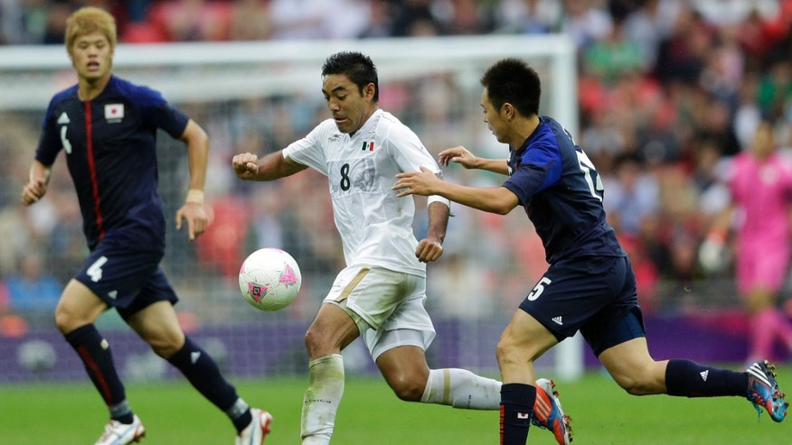 Aug. 7, 2012: Mexico's Marco Fabian, center, challenges for the ball with Japan's Manabu Saito, right, and Hiroki Sakai, left, during the men's soccer semifinal match at Wembley Stadium at the 2012 Summer Olympics in London. Mexico won 3-1.
