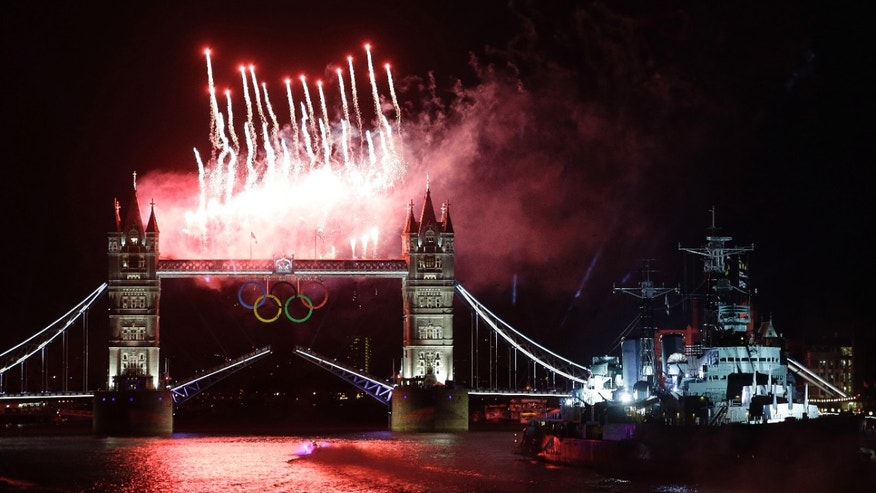 July 27, 2012: Fireworks illuminate the sky over the Tower Bridge and River Thames in London during the Opening Ceremony at the 2012 Summer Olympics.